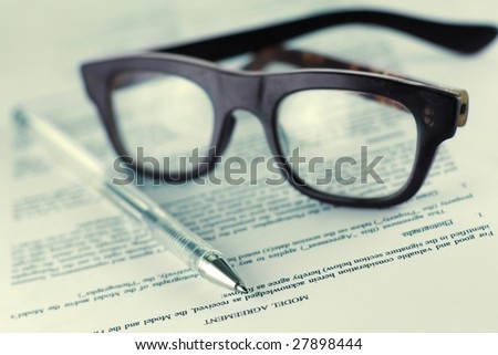 Eye-glasses with paper and pen