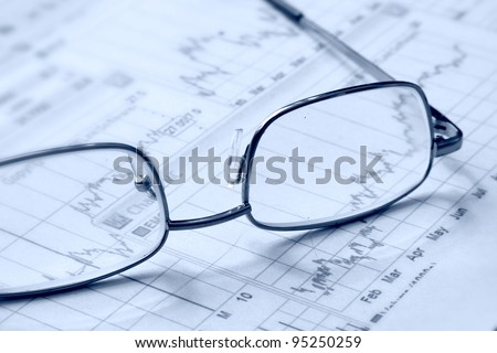Eyeglasses laying down on a business document