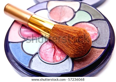 Eyeshadows kit with the brush isolated on white