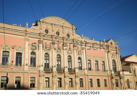 facade of an old pink palace in st. petersburg in russia