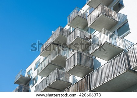 facade with balconies, esidential building, concrete house, apartment house, residential architecture symbol, symbol of modern living