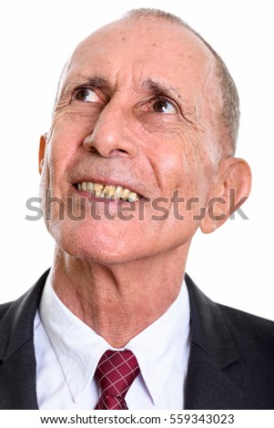 Face of happy senior businessman smiling while thinking isolated against white background