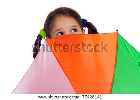 Face of little girl holding colored umbrella and looking to sky