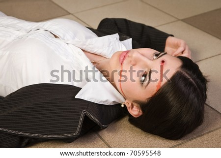 Face of the killed businesswoman in a office