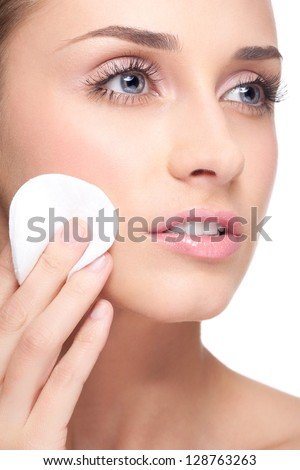 Face of young beautiful woman with hygiene cotton pads
