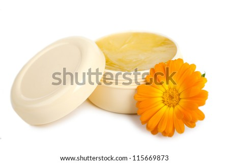 Face or hand cream with orange flower