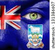 Face with Falkland Islands flag painted to show support - stock photo