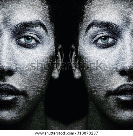 Faces of male twins with textured skin