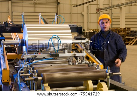 Factory worker using steel coil processing machine - a series of METAL INDUSTRY images.