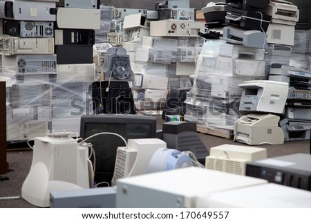 FAIRFAX, VA - DECEMBER 5: Many computers and printers to be recycled stacked at a dumpster on December 5, 2013 in Fairfax, VA. Components, plastic and metal will be separated and melted.