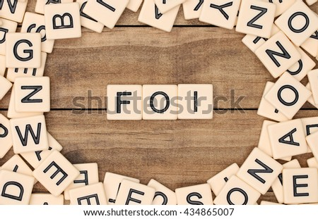 Faith in French spelled out in tan tile letters