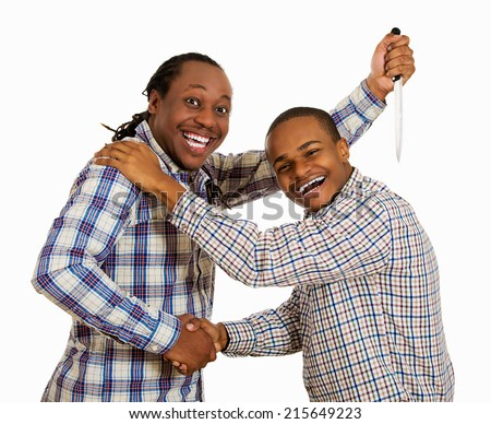 Fake friend backstabbing concept. Portrait hypocrite, crafty man gives handshake to a guy at same time trying to stab him in back with knife isolated white background. Human emotion expression feeling