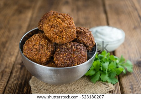 Falafel (close-up shot; selective focus) on an old wooden table