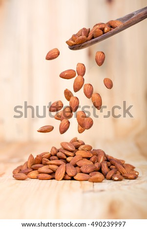 Falling Almond on wood background