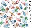 Falling Euro banknotes isolated on white background - stock