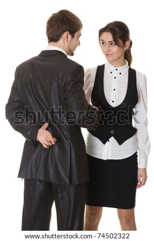 false deal, man and woman doing the handshake, the man crossed his fingers behind his back, isolated on white