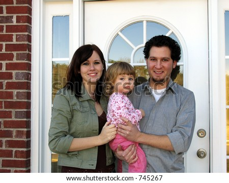 Family at the front door of their new home