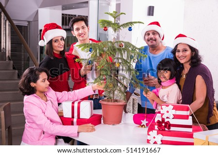 family christmas holidays and people concept happy indian kids decorating christmas tree - People Decorating A Christmas Tree