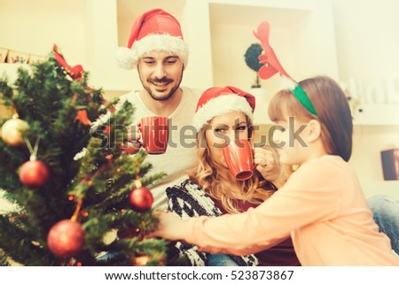 family decorating christmas tree and having funfamily christmas winter happiness and - People Decorating A Christmas Tree