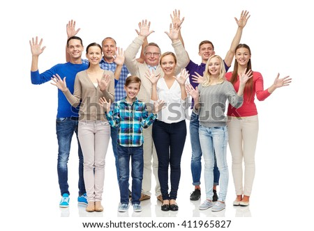 family, gender, generation and people concept - group of smiling men, women and boy waving hands