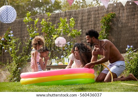 Father son playing game on sofa stock photo 560436097 for Family garden pool