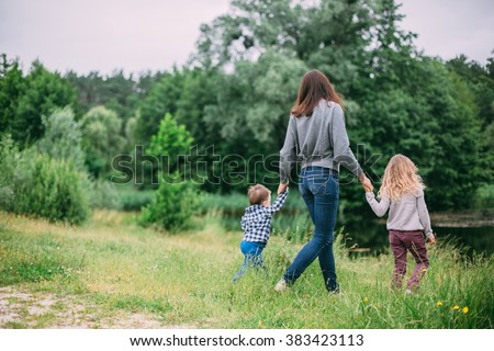 family having fun outdoors in the green park