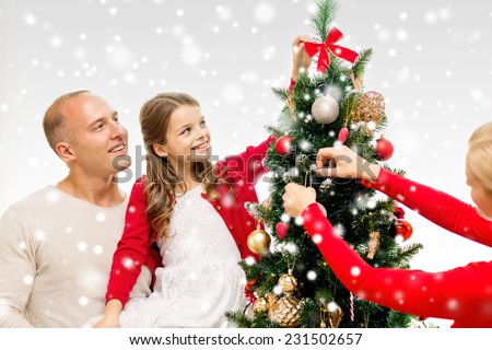 decorating with christmas cute young couple decorating christmas tree stock photo 485898700