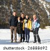 Family in a and outdoor winter setting. - stock photo