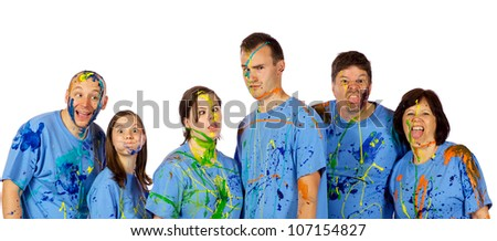 Family just got done having a paint fight and are making faces at the camera