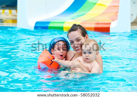 Family of four having fun in the pool