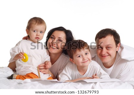 family of three on the bed