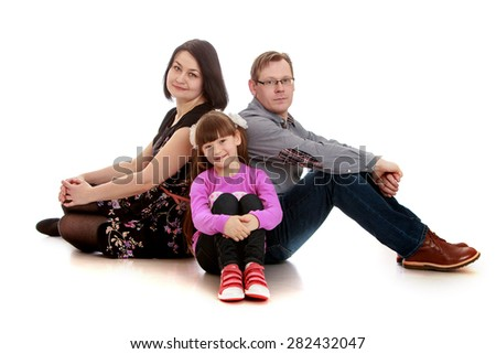 Family photo mom dad and daughter- isolated on white background