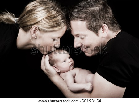 Family portrait of a twenty days old baby and his parents