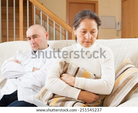 Family quarrel. Woman having problems with her husband at home