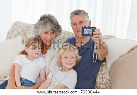Family taking a photo of themselves at home