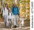 Family trekking with dog - stock photo