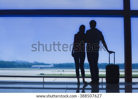 Family waiting for the flight at the airport. transportation concept