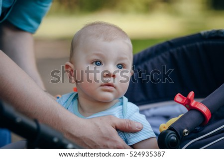 family with child walking in the park