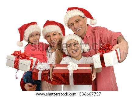 family with kids   in santa hats with gifts