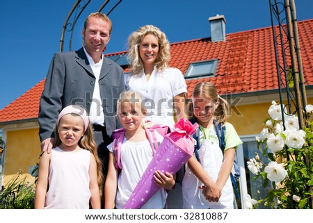 Family with three kids sending them to school