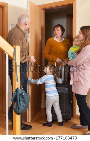 Family with two children coming to grandmother home