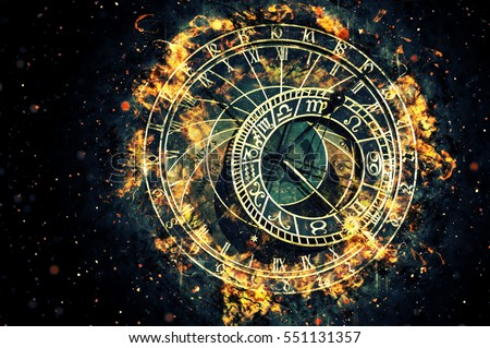 Famous astronomical clock at Prague, Czech Republic. Fire illustration.
