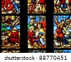 Famous colorful stained-glass windows in the Duomo Cathedral. Milan. Italy. - stock photo