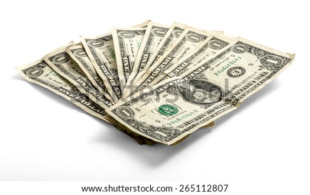 Fanned used one US dollar bills lying on a white background in a financial and money concept, low angle view