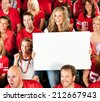 Fans: Pretty Girl Holds Up Sign During Football Game - stock photo