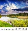 Fantastic landscape with lake and dramatic sky. Overcast sky. Carpathian, Ukraine, Europe. Beauty world. - stock photo