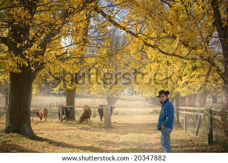 farmer checks the cows on the farm in autumn