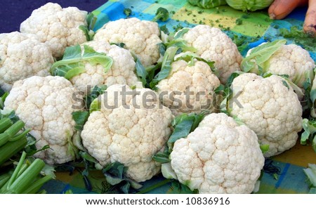 farmer's market cauliflower display on a colorful tablecloth