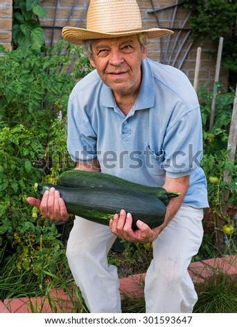 Farmer with a huge zucchini
