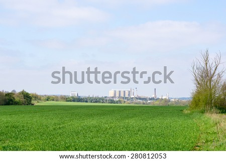 Farmland and sugar beet fatctory in the background in bury St Edmunds, Suffolk, England